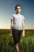 Teenager in a wheat field — Stock Photo