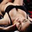 Sexy sensual brunette lying in bed — Stock Photo