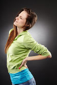 Young woman having a severe lumbar pain — Stock Photo