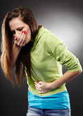 Sick woman about to throw up holding her stomach — Stock Photo