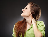 Young woman with a severe pain in the neck — Stock Photo