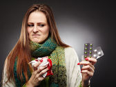Woman holding a cup of hot tea and expressing disgust to some bl — Stock Photo