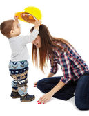 "Mother playing with her son ""construction worker"" — ストック写真"