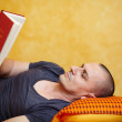 Stock Photo: Casual man reading a book