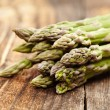 Raw asparagus on wooden board — Stock Photo #39791069