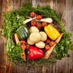 Vegetables and herbs nest arrangement — Stock Photo #39791525