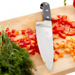 Knife and chopped vegetables — Stock Photo