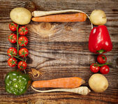 Vegetables frame on wooden board — Stock Photo