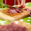 Slicing chicken liver — Stock Photo