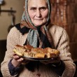 Old woman with homemade cookies — Stock Photo #40176709