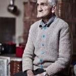 Pensive old man indoor — Stock Photo #40176731