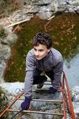 Teenager boy climbing — Stock Photo