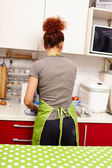 Woman cook, with the back to the camera — Stock Photo