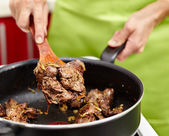 Preparing fried chicken liver with onions — Stock Photo