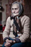 Old woman indoors — Stock Photo