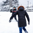 Teenager throwing snowballs — Stock Photo