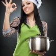 Hispanic woman cook with pot making ok sign — Stock Photo