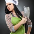 Stock Photo: Womcook holding meat chopper