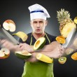 Stock Photo: Fast cook slicing vegetables in mid-air