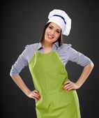 Beautiful woman cook standing akimbo — Stock Photo