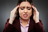 Businesswoman with a strong migraine — Stock Photo
