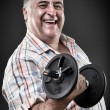 Happy fat man with dumbbell — Stock Photo