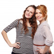 Stock Photo: Happy girlfriends standing embraced and smiling