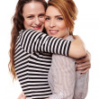 Stock Photo: Two happy girlfriends hugging each other
