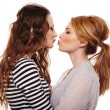 Stock Photo: Two playful girlfriends hugging and kissing each other