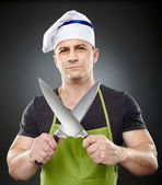 Man cook holding two big sharp knives — Stock Photo