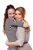 Two happy girlfriends hugging each other — Stock Photo