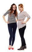 Girlfriends standing akimbo — Stock Photo