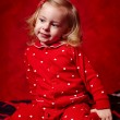 Stock Photo: Girl toddler in her pajamas before sleeping