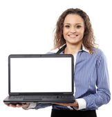 Businesswoman presenting a laptop with copyspace on the monitor — Stock Photo