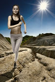 Athlete running with the sun behind — Stock Photo