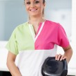 Beautiful woman dentist at the office — Stock Photo #43844645