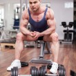 Athletic man resting on a bench at the gym — Stock Photo #43845477