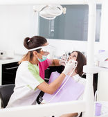 Woman dentist working with the driller — Stock Photo