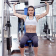Woman at shoulder press — Stock Photo #44877457