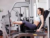 Woman working quads — Stock Photo