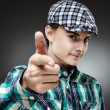 Teenage boy pointing at camera — Stock Photo #45032083