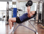 Chest workout on bench press — Stock Photo