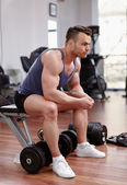 Athletic man preparing for workout — Stock Photo