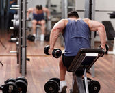 Man working out in front of the mirror — Stock Photo