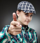 Teenage boy pointing at camera — Stock Photo
