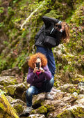 Women tourists taking photos — Stock Photo
