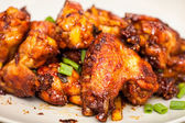 Caramelized chicken wings — Stock Photo
