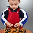 Kid learning to play chess — Stock Photo #47833555