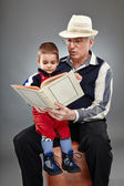 Grandpa reading fairytales to toddler — Stock Photo