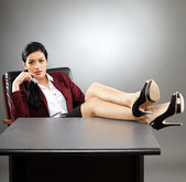 Manager putting her feet up — Stock Photo